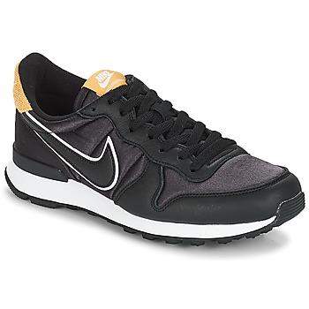 Chaussures Femme Baskets basses Nike INTERNATIONALIST HEAT Noir / Doré